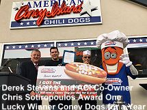 Derek Stevens and ACI Co owner Chris Sotiropoulos award Coney dogs for a year